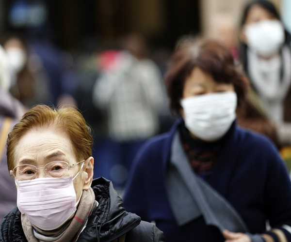 UPDATE 4-China Says 17 New Cases in Virus Outbreak, Wuhan to Restrict Large Gatherings