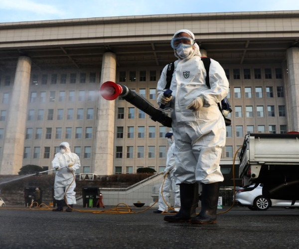 South Korea Virus Cases Jump Again; 1st US Soldier Infected